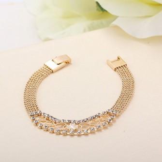 Sublime Bracelet plaqué or 18k - 750/000 avec ses nombreuses pierres de zirconium 01D1073