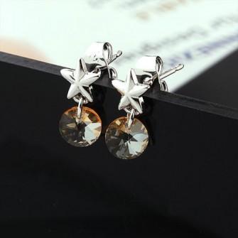 Boucles d'oreilles étoile couleur champagne 01A2571
